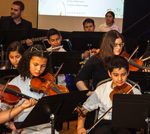 Harmony project orchestra students performing